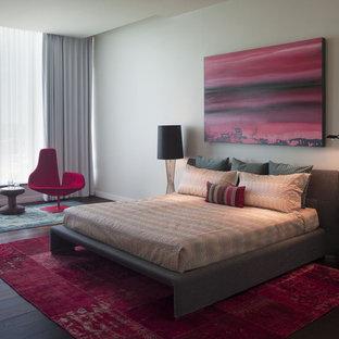 Minimalist master dark wood floor bedroom photo in Austin with gray walls