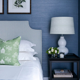 Inspiration for a mid-sized traditional guest bedroom in Sydney with blue walls, carpet, beige floor and wallpaper.