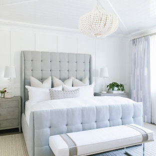 Design ideas for a beach style master bedroom in San Diego with white walls, timber and panelled walls.