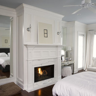 Example of a classic bedroom design in Charleston with a standard fireplace
