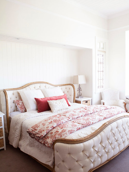 example of a large classic master carpeted bedroom design in brisbane with white walls