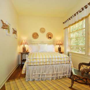 Inspiration for a country bedroom in San Francisco with yellow walls.