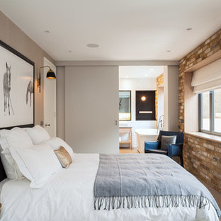 Example of a trendy bedroom design in London with beige walls