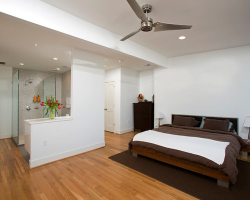 Large contemporary guest light wood floor bedroom idea in DC Metro with  white walls. Open Bathroom   Houzz