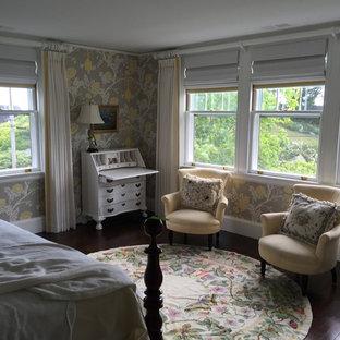 На фото: хозяйская спальня среднего размера в классическом стиле с синими стенами, ковровым покрытием, стандартным камином, фасадом камина из дерева и бежевым полом с