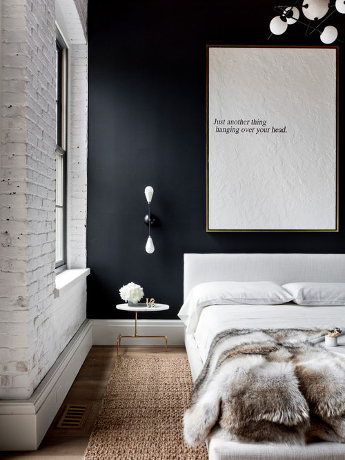 example of an urban bedroom design in new york with black walls - Houzz Bedroom Design