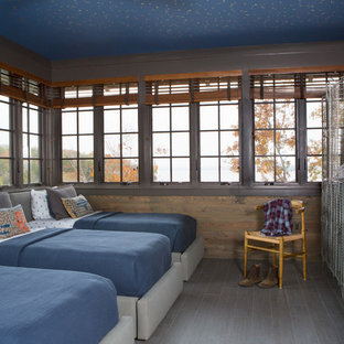 Example of a mid-sized mountain style guest ceramic tile and gray floor bedroom design in Nashville with brown walls