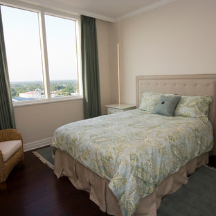 Example of a mid-sized classic guest dark wood floor bedroom design in Tampa with beige walls and no fireplace