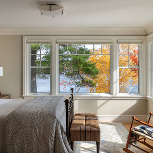 Inspiration for a beach style light wood floor bedroom remodel in Boston with gray walls