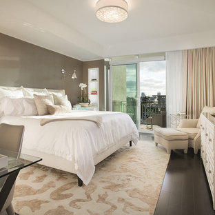 Example of a transitional dark wood floor bedroom design in Miami with gray walls