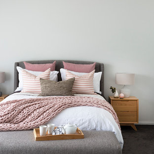 Scandinavian bedroom in Brisbane with white walls, carpet and black floor.