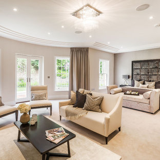 Example of a trendy master carpeted bedroom design in Surrey with gray walls
