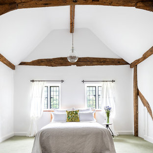 This is an example of a farmhouse bedroom in Surrey.