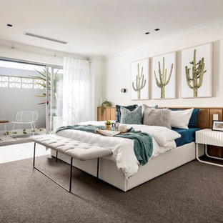 Inspiration for a contemporary master bedroom in Perth with white walls, carpet and brown floor.