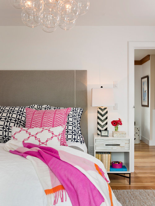 inspiration for a timeless medium tone wood floor bedroom remodel in providence with white walls - Black And Pink Bedroom Ideas