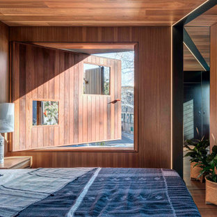Inspiration for an industrial bedroom in Sydney with wood and wood walls.