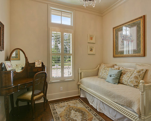 Charming Inspiration For A Timeless Guest Bedroom Remodel In New Orleans With Beige  Walls And Dark Hardwood