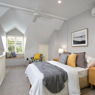Transitional loft-style bedroom in Sydney with grey walls, carpet, no fireplace and grey floor.