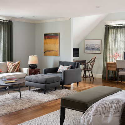 Mid-sized transitional master medium tone wood floor and brown floor bedroom photo in Boston with gray walls and no fireplace