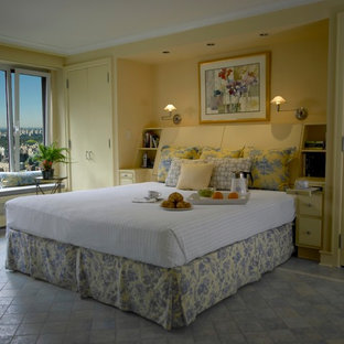Inspiration for a large transitional master bedroom in New York with yellow walls and ceramic floors.