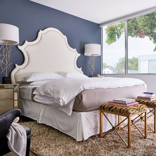 Example of a mid-sized transitional master medium tone wood floor and brown floor bedroom design in Dallas with white walls