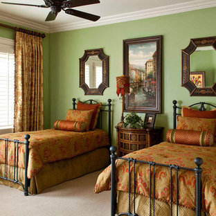 Mid-sized tuscan guest carpeted bedroom photo in Other with green walls