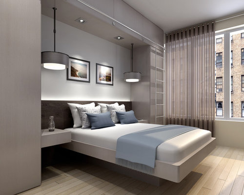 Inspiration For A Mid Sized Modern Master Light Wood Floor Bedroom Remodel  In New York