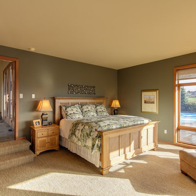 Example of a classic carpeted bedroom design in Seattle with gray walls