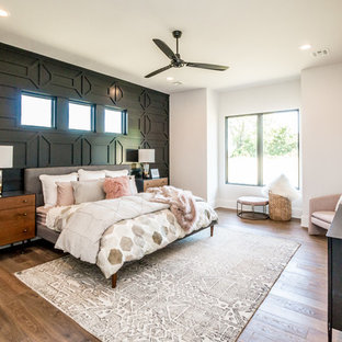 Example of a large trendy master dark wood floor and brown floor bedroom design in Other with white walls