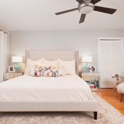 Transitional master medium tone wood floor bedroom photo in Austin with gray walls