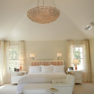Inspiration for a timeless bedroom remodel in New York with beige walls