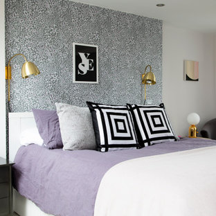 Medium sized classic master bedroom in London with purple walls, carpet and grey floors.