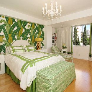 Trendy medium tone wood floor bedroom photo in Los Angeles with green walls