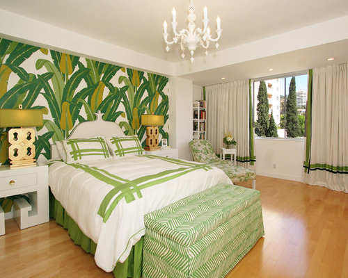 Trendy Medium Tone Wood Floor Bedroom Photo In Los Angeles With Green Walls