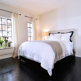 Inspiration for a small industrial master bedroom in Los Angeles with white walls, dark hardwood floors and black floor.