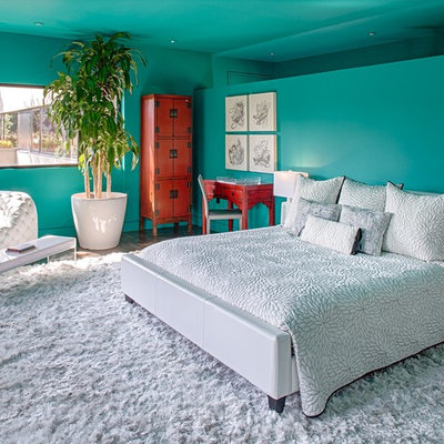 Inspiration for a contemporary dark wood floor bedroom remodel in Austin with blue walls and no fireplace