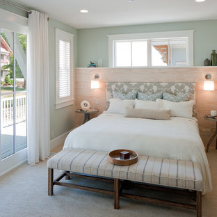 Mid-sized beach style master bedroom in Grand Rapids with green walls, carpet, no fireplace and brown floor.