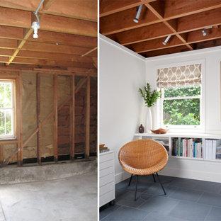 Diseño de dormitorio actual, pequeño, con paredes blancas y suelo de pizarra