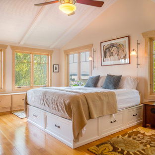 Inspiration for a beach style medium tone wood floor bedroom remodel in Seattle with beige walls and no fireplace
