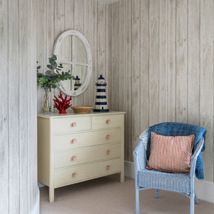 Design ideas for a small nautical bedroom in London with beige walls, carpet and beige floors.