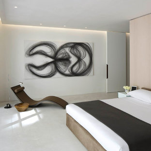 Inspiration for a modern master concrete floor bedroom remodel in New York with white walls