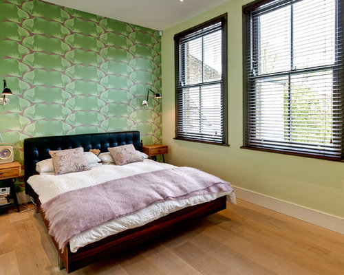 Inspiration for a bohemian master bedroom in London with green walls and  light hardwood flooring. Sage Green Bedroom Ideas and Photos   Houzz