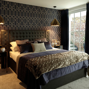 Medium sized modern bedroom in London with grey walls, carpet and grey floors.
