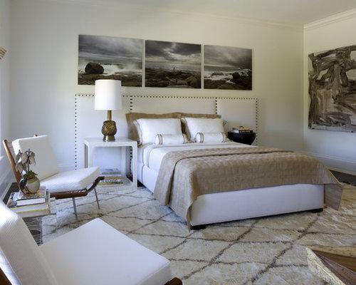 Trendy dark wood floor bedroom photo in New York with white walls