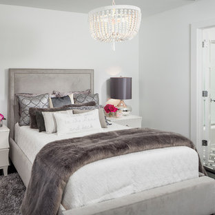 Inspiration for a transitional master black floor bedroom remodel in Orlando with white walls and no fireplace
