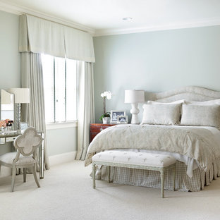 Large elegant master carpeted bedroom photo in Charlotte with blue walls and no fireplace