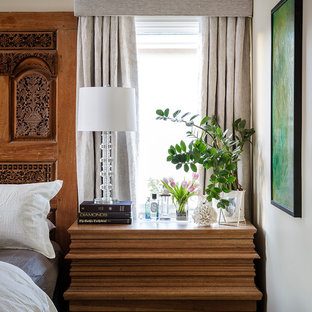 Design ideas for a mid-sized transitional master bedroom in Los Angeles with beige walls, porcelain floors, a standard fireplace, a stone fireplace surround and multi-coloured floor.