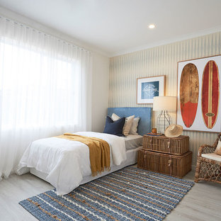 Photo of a beach style bedroom in Melbourne with white walls, light hardwood floors and beige floor.