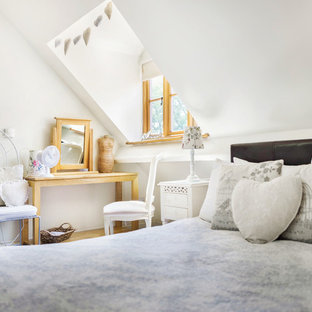 Design ideas for a small rural bedroom in Other with white walls.