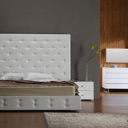 White Modern Leather Platform Bed with Crystals - This white leather modern bed features a rich leather match material upholstery, and artificial crystals embedded in the tufting. The tufting is evenly spread throughout the headboard and bottom of the low profile frame. This beautiful bed comes with slats so no box spring is required. Matching set pieces are available as well such as standing mirror, wall mirror, dresser and chaise.